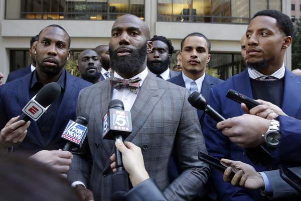 Former NFL football player Anquan Boldin, left, Philadelphia Eagles Malcolm Jenkins, center, and San Francisco 49ers Eric Reid, right, speak to the media outside the league's headquarters after meetings in New York. San Francisco 49ers linebacker Eric Reid says he left The Players Coalition because founder Malcolm Jenkins excluded Colin Kaepernick from meetings, and asked players if they would stop protesting the anthem if the NFL made a charitable donation to causes they support. (AP Photo/Richard Drew, File)
