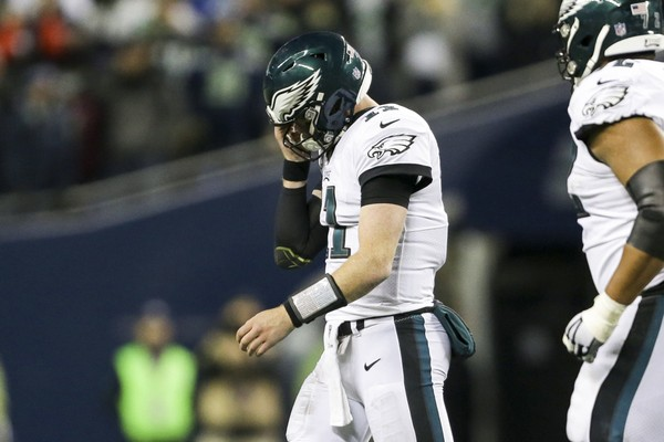 Philadelphia Eagles quarterback Carson Wentz (11) reacts after a failed fourth down play against the Seattle Seahawks during the fourth quarter at CenturyLink Field.