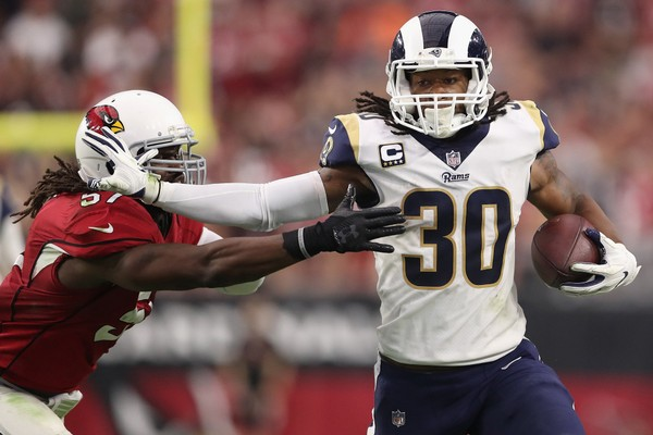 Running back Todd Gurley #30 of the Los Angeles Rams runs past linebacker Josh Bynes #57 of the Arizona Cardinals during the first half of the NFL game at the University of Phoenix Stadium on December 3, 2017 in Glendale, Arizona.  (Photo by Christian Petersen|Getty Images)