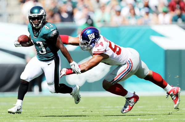Darren Sproles of the Philadelphia Eagles carries the ball as Olivier Vernon of the New York Giants defends on September 24, 2017  at Lincoln Financial Field in Philadelphia, Pa. (Elsa | Getty Images)