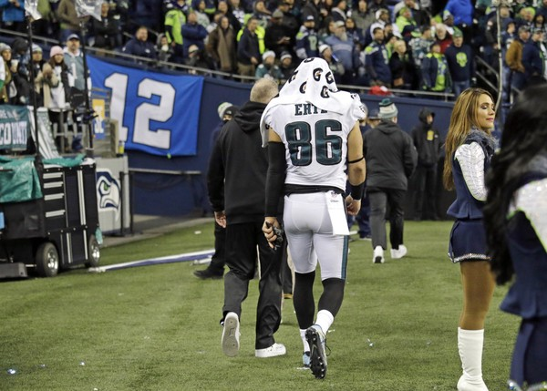 Eagles' Zach Ertz is led away from the field after being injured against the Seattle Seahawks.