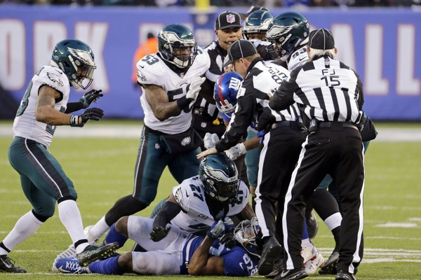 New York Giants wide receiver Sterling Shepard (87) and Philadelphia Eagles strong safety Malcolm Jenkins (27) scuffle at the bottom of a pile during the second half of an NFL football game Sunday, Dec. 17, 2017, in East Rutherford, N.J. (AP Photo/Seth Wenig)