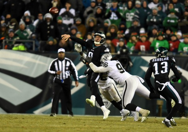 Philadelphia Eagles quarterback Nick Foles passes under pressure from Oakland Raiders defensive end Denico Autry (96) in the fourth quarter at Lincoln Financial Field.(James Lang | USA TODAY Sports)