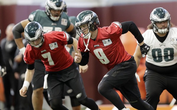 Philadelphia Eagles quarterback Nick Foles (9) and quarterback Nate Sudfeld (7) run drills during a practice for the NFL Super Bowl 52 football game Wednesday, Jan. 31, 2018, in Minneapolis. Philadelphia is scheduled to face the New England Patriots Sunday. (AP Photo/Eric Gay)