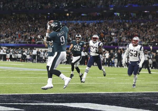 Philadelphia Eagles quarterback Nick Foles (9) catches a touchdown pass from tight end Trey Burton, in the second quarter against the New England Patriots in Super Bowl LII, Sunday, Feb. 4, 2018 in Minneapolis. The Eagles defeated the Patriots 41-33 to win their first Super Bowl. (AP Photo/Doug Benc)