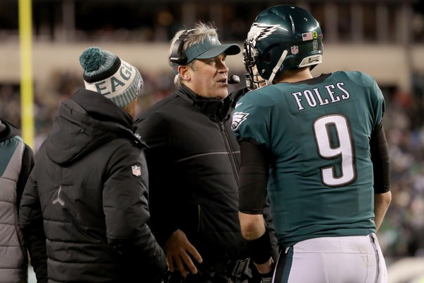 Head coach Doug Pederson of the Philadelphia Eagles talks Nick Foles #9 on the sidelines against the Atlanta Falcons during the fourth quarter in the NFC Divisional Playoff game at Lincoln Financial Field on January 13, 2018 in Philadelphia, Pennsylvania.  (Photo by Abbie Parr/Getty Images)
