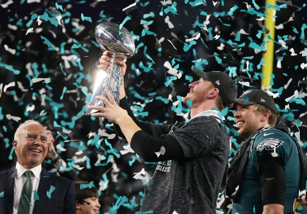 Eagles quarterback Carson Wentz celebrates with the Lombardi Trophy after defeating the New England Patriots 41-33 in Super Bowl LII