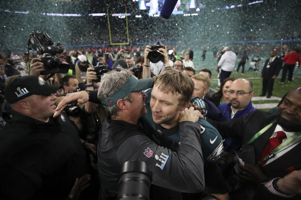 Philadelphia Eagles coach Doug Pederson, left, embraces Eagles quarterback Nick Foles after their team won Super Bowl LII against the New England Patriots on Sunday, Feb. 4, 2018, in Minneapolis, Minn. Foles was named the game's MVP. He took over as the Eagles starter after Carson Wentz went out late in the season with a knee injury. (Jerry Holt/Minneapolis Star Tribune/TNS)