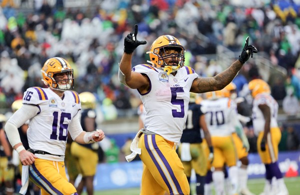 LSU Tigers running back Derrius Guice (5) celebrates a touchdown with quarterback Danny Etling (16) against the Notre Dame Fighting Irish in the 2018 Citrus Bowl at Camping World Stadium. (Matt Stamey-USA TODAY Sports)