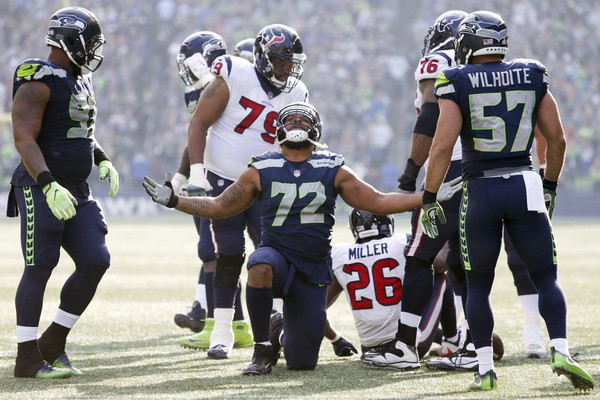 Seattle Seahawks defensive end Michael Bennett (72) celebrates after making a tackle for a loss during the second quarter at CenturyLink Field.