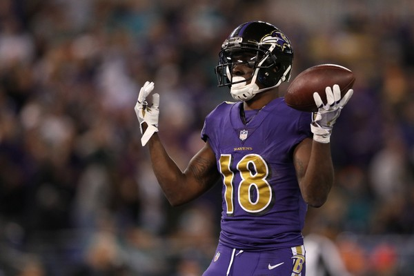 Wide Receiver Jeremy Maclin #18 of the Baltimore Ravens celebrates after a first quarter touchdown against the Miami Dolphins.