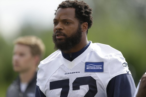 Eagles defensive end Michael Bennett turned himself in to authorities in Houston on Monday. (AP Photo | Ted S. Warren, File)