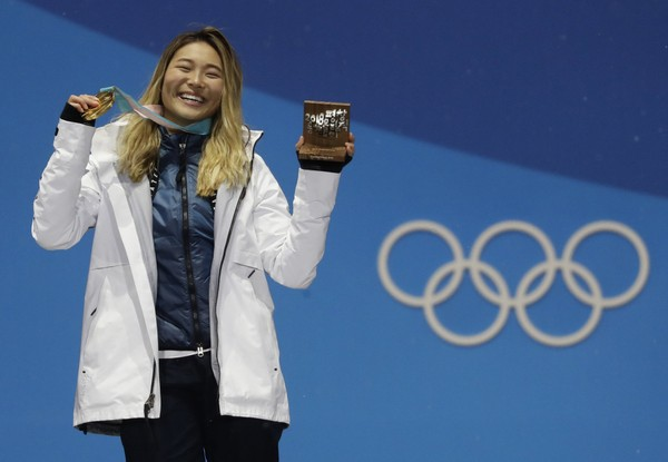 Women's halfpipe gold medalist Chloe Kim poses during the medals ceremony at the 2018 Winter Olympics in Pyeongchang, South Korea, Tuesday, Feb. 13, 2018. (AP Photo/Morry Gash)