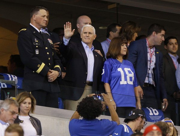 Vice President Mike Pence waves to fans before an NFL football game between the Indianapolis Colts and the San Francisco 49ers, Sunday, Oct. 8, 2017, in Indianapolis. (AP Photo/Michael Conroy)
