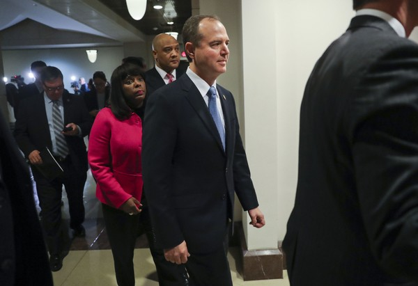 Rep. Adam Schiff, D- Calif., center, ranking member of the House Intelligence Committee, walks back to the meeting room after speaking to members of the media, Monday, Jan. 29, 2018 on Capitol Hill in Washington.