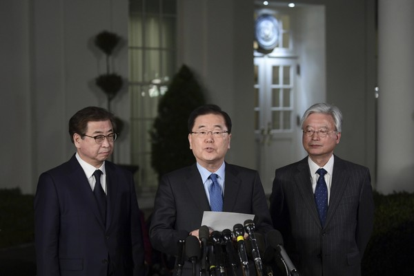 South Korean national security director Chung Eui-yong, center, speaks to reporters at the White House in Washington, Thursday, March 8, 2018, as intelligence chief Suh Hoon, left and Cho Yoon-je, the South Korea ambassador to United States listen. President Donald Trump has accepted an offer of a summit from the North Korean leader and will meet with Kim Jong Un by May, a top South Korean official said. (AP Photo/Susan Walsh)