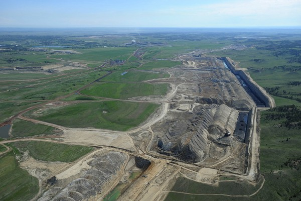 This photo taken May 25, 2013, shows an aerial view of Colstrip power plants 1,2,3 & 4 and the Westmoreland coal mines near Colstrip, Mont.
