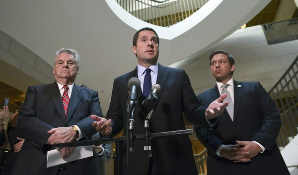 FILE - In this Oct. 24, 2017, file photo, House Intelligence Committee Chairman Rep. Devin Nunes, R-Calif., center, standing with Rep. Peter King, R-N.Y., left, and Rep. Ron DeSantis, R-Fla., right, speaks on Capitol Hill in Washington.