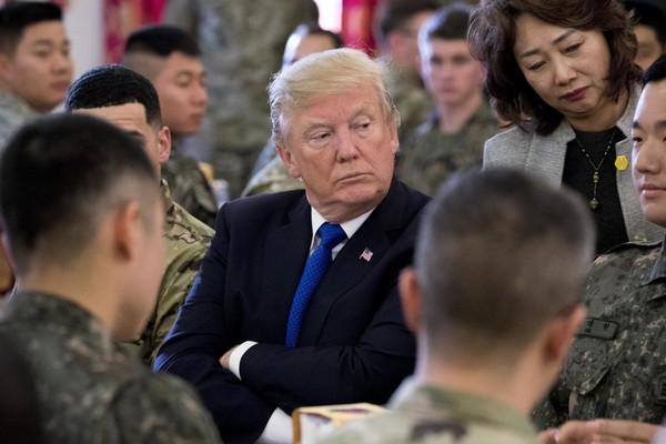 President Donald Trump has lunch with U.S. and South Korean troops along with South Korean President Moon Jae-in at Camp Humphreys in Pyeongtaek, South Korea, Tuesday, Nov. 7, 2017. Trump is on a five country trip through Asia traveling to Japan, South Korea, China, Vietnam and the Philippines. (AP Photo/Andrew Harnik)
