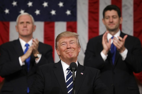 In this Feb. 28, 2017, file photo, President Donald Trump addresses a joint session of Congress on Capitol Hill in Washington, as Vice President Mike Pence and House Speaker Paul Ryan of Wis., applaud. President Trump's first state of the union speech will carry more suspense than most. (Jim Lo Scalzo/Pool Image via AP, File)