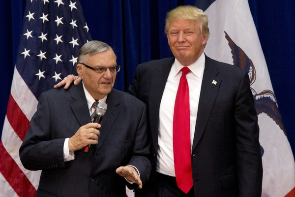 FILE - In this Jan. 26, 2016 file photo, then-Republican presidential candidate Donald Trump is joined by Joe Arpaio, the sheriff of metro Phoenix, at a campaign event in Marshalltown, Iowa. (AP Photo/Mary Altaffer, File)
