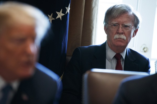 National security adviser John Bolton listens as President Donald Trump speaks during a cabinet meeting at the White House, Monday, April 9, 2018, in Washington. (AP Photo/Evan Vucci)
