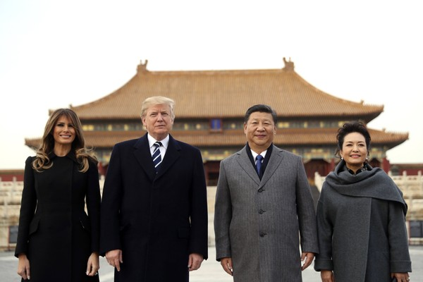 U.S. President Donald Trump, second left, first lady Melania Trump, left, Chinese President Xi Jinping and his wife Peng Liyuan stand together as they tour the Forbidden City in Beijing, China on Nov. 8, 2017.