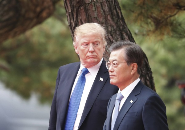 U.S. President Donald Trump, left, and South Korea's President Moon Jae-in attend a welcoming ceremony at the Presidential Blue House in Seoul, South Korea, Tuesday, Nov. 7, 2017. (Kim Hong-Ji/Pool Photo via AP)