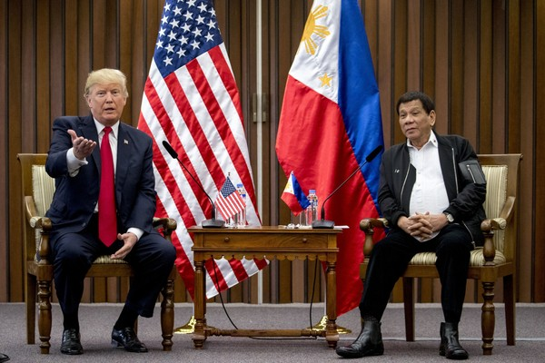 U.S. President Donald Trump, left, accompanied by Philippines President Rodrigo Duterte, speaks during a bilateral meeting at the ASEAN Summit at the Philippine International Convention Center on Monday, Nov. 13, 2017, in Manila, Philippines.