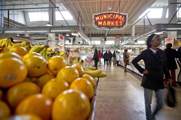 This file photo shows shoppers passing through the Sweet Auburn Curb Market in Atlanta. (AP Photo/David Goldman, File)