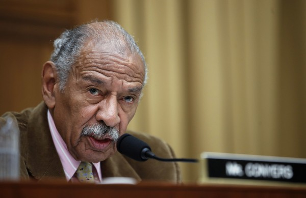 """FILE- In this April 4, 2017, file photo, Rep. John Conyers, D-Mich., speaks during a hearing of the House Judiciary subcommittee on Capitol Hill in Washington. House Democratic Leader Nancy Pelosi is defending Conyers as an """"icon"""" for women's rights and declining to say whether the longtime lawmaker should resign over allegations that he sexually harassed female staff members."""