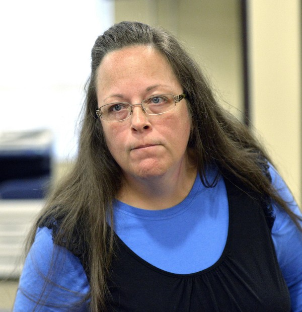 In this Sept. 1, 2015, file photo, Rowan County Clerk Kim Davis listens to a customer at the Rowan County Courthouse in Morehead, Ky.  (AP Photo/Timothy D. Easley, File)