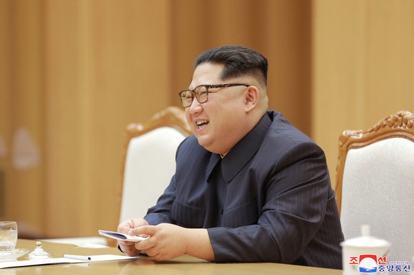 In this April 14, 2018, photo provided Monday, April 16, 2018, by the North Korean government, North Korean leader Kim Jong Un, talks with Song Tao, unseen, head of the ruling Communist Party's International Department, during a meeting in Pyongyang, North Korea.