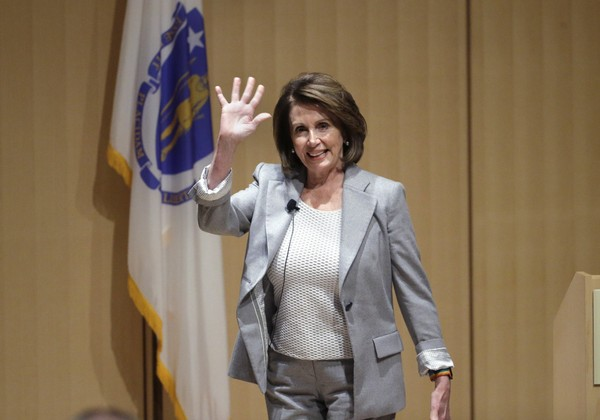House Minority Leader Nancy Pelosi of Calif., waves as she arrives at a town hall-style meeting, Thursday, Feb. 1, 2018, at the Cambridge Public Library, in Cambridge, Mass.