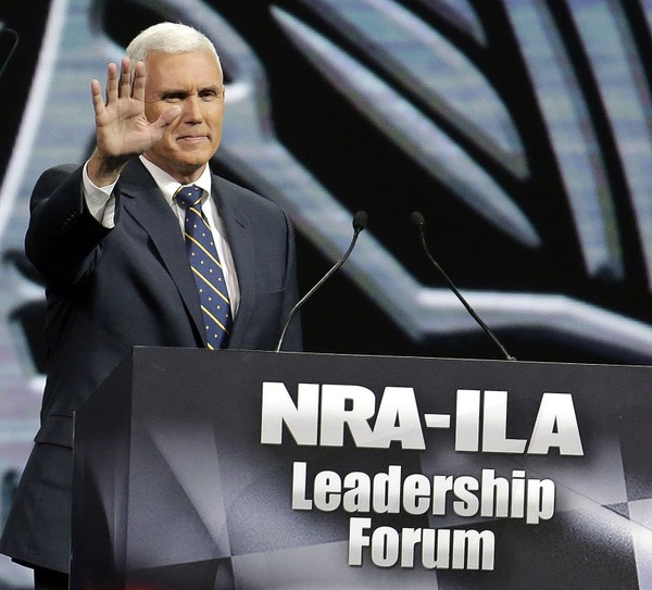 Mike Pence waves after speaking at the leadership forum at the National Rifle Association's annual convention
