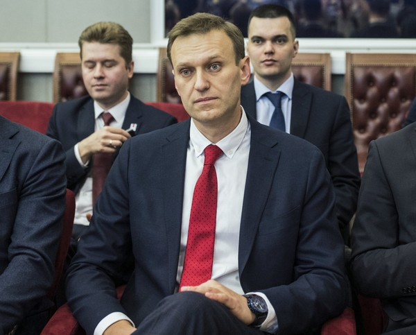 Russian opposition leader Alexei Navalny, who submitted endorsement papers necessary for his registration as a presidential candidate, center, sits at the Russia's Central Election commission in Moscow, Russia, Monday, Dec. 25, 2017. Russian election officials have formally barred Russian opposition leader Alexei Navalny from running for president.