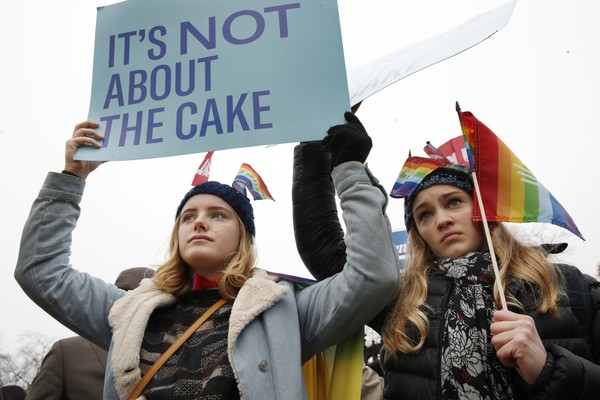 Lydia Macy, 17, left, and Mira Gottlieb, 16, both of Berkeley, Calif., rally outside of the Supreme Court which is hearing the 'Masterpiece Cakeshop v. Colorado Civil Rights Commission' today, Tuesday, Dec. 5, 2017, in Washington. (AP Photo/Jacquelyn Martin)