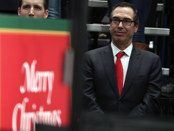Treasury Secretary Steve Mnuchin listens as President Donald Trump speaks about tax reform at the St. Charles Convention Center, Wednesday, Nov. 29, 2017, in St. Charles, Mo.
