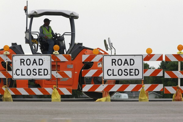 In this June 22, 2016, file photo, road construction crews work to build a four lane highway on Route 29 in Edinburg, Ill.