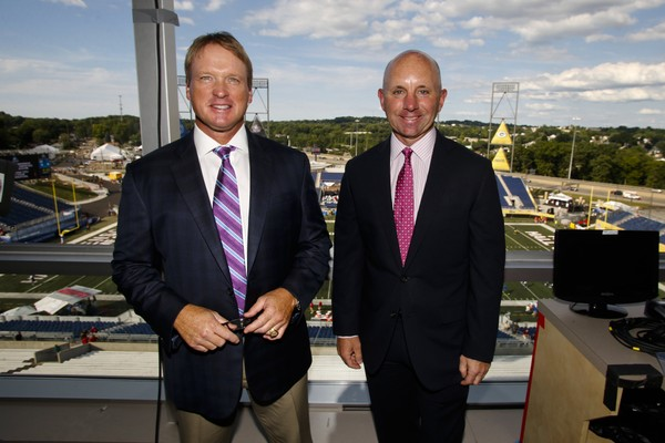 In this Aug. 7, 2016, file photo, ESPN Monday Night Football announcers Jon Gruden, left, and Sean McDonough stand in the press box of Tom Benson Hall of Fame Stadium before a preseason NFL football game between the Green Bay Packers and the Indianapolis Colts, in Canton, Ohio.