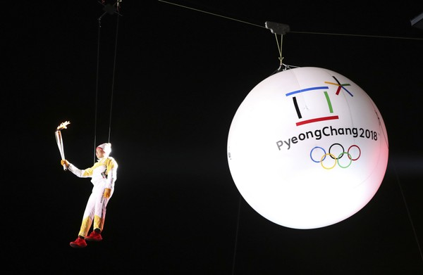 South Korean Ryu Seung-min, a member of the IOC Athletes Commission, carries the Olympic torch as he hangs from a wire during the Olympic Torch Relay in Incheon, South Korea, Wednesday, Nov. 1, 2017. The Olympic flame arrived in South Korea Wednesday where it will be passed throughout the country by thousands of torchbearers on a 100-day journey to the opening ceremony of the 2018 Winter Olympics in Pyeongchang. (AP Photo/Lee Jin-man)