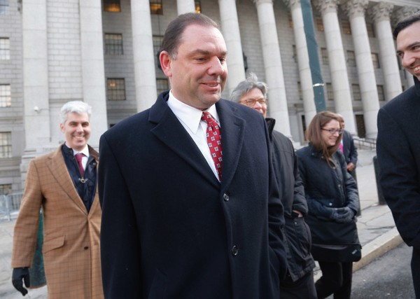 Joseph Percoco, center, former top aide to Gov. Andrew Cuomo accused of bribery, leaves court after a judge dismissed a jury for the weekend in his trial, Friday March 9, 2018 in New York. (Associated Press)