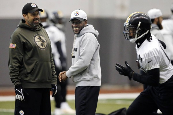 Antonio Brown and Todd Haley seem to be OK now, Haley said. Brown swiped away the offensive coordinator's hand when he tried to grab Brown mid-sideline tantrum on Sunday.  Here, Brown and Haley watch as Martavis Bryant, right, runs a drill before facing the Denver Broncos in an NFL Divisional playoff football game in Denver in January of 2016.. (AP Photo/Gene J. Puskar)