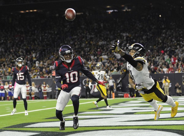 Steelers cornerback Joe Haden stretches out on one of his many plays shadowing DeAndre Hopkins on Monday in Pittsburgh's 34-6 win against the Houston Texans at NRG Stadium. (AP Photo/Eric Christian Smith)