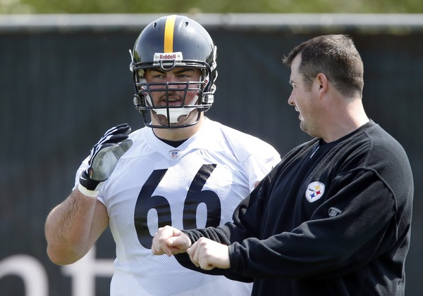 Then-Pittsburgh Steelers offensive assistant coach and now assistant offensive line coach Shaun Sarrett works with David DeCastro during practice, Wednesday, May 22, 2013, in Pittsburgh. (AP Photo/Keith Srakocic)