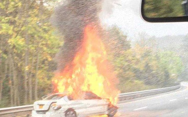 A car ignited Sunday, Oct. 15, 2017 after the driver of a sedan crashed into the center guardrail along Route 80 in Allamuchy Township.