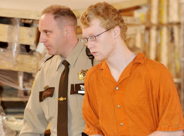 Zachary D. Flowers, of Allentown, is escorted by a Lehigh County Sheriff deputy to his extradition hearing Jan. 17, 2012.