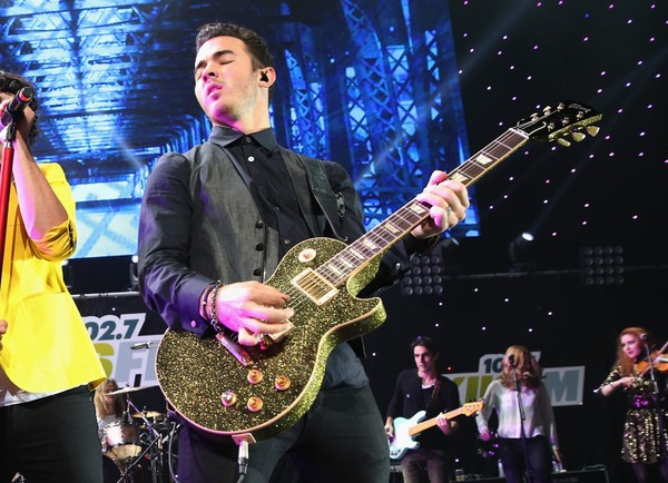 Kevin Jonas of The Jonas Brothers performs onstage during KIIS FM's 2012 Jingle Ball in Los Angeles.