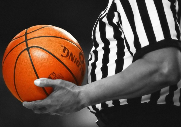 """A now-suspended volunteer youth basketball coach is being portrayed as a """"villain"""" for what was """"merely a error in judgement and acting with his emotions"""" over foul calls, leading to his ejection from an under-12 game, the president of the sports organization says."""