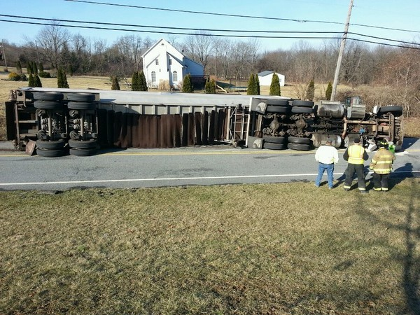 Manure Truck Rolled : Truck rolls over after sharp curve on new jersey road